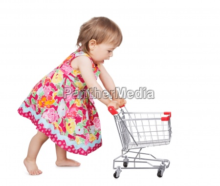 little girl pushing a trolley