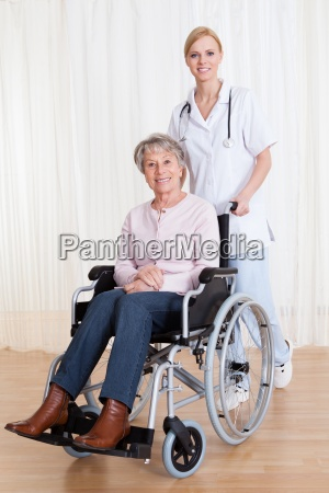 caring doctor helping handicapped patient
