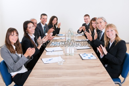 business team sitting at table and