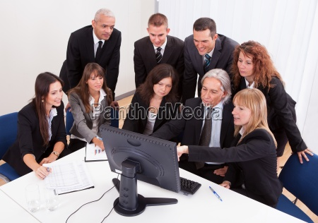 mature businessman with team discussing