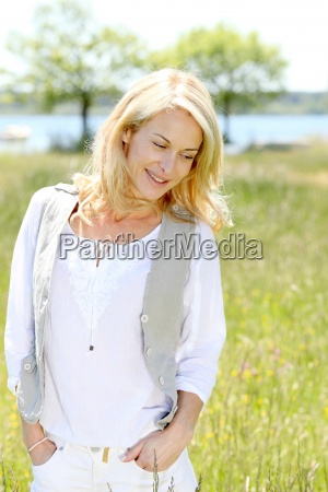 beautiful woman standing in country field