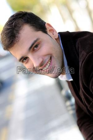 portrait of handsome guy in town