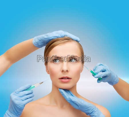 woman face and beautician hands with
