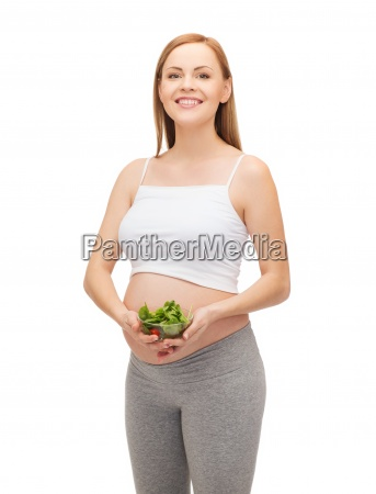 happy future mother with bowl of