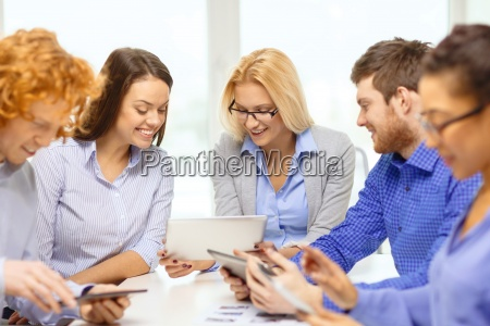 smiling team with table pc and