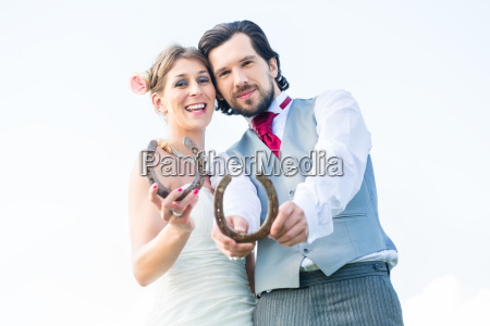 bride and groom with horseshoe as