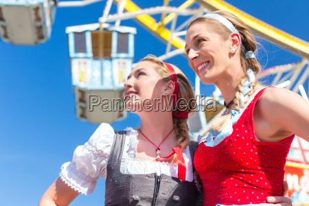 girlfriends attend folk festival have fun
