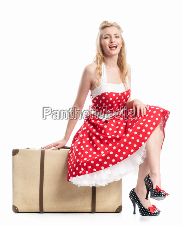 a pinup girl sitting on a