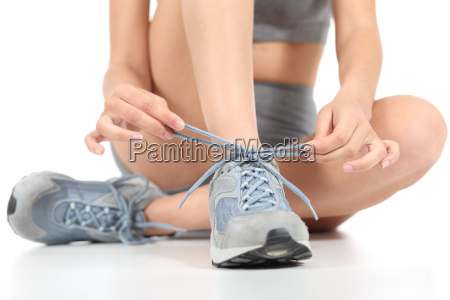 runner fitness woman tying the shoelaces