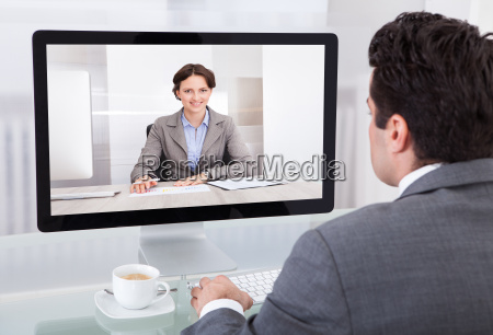 businessman chatting with colleague