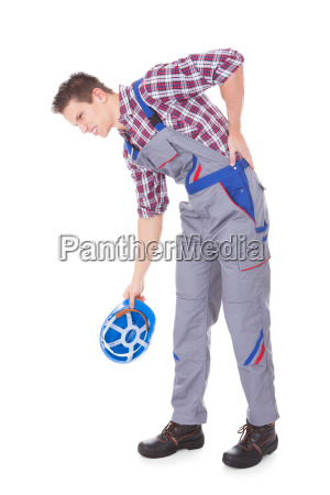 male worker suffering from back pain