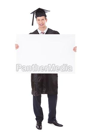graduate man with white billboard