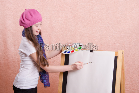 girl begins to draw picture on