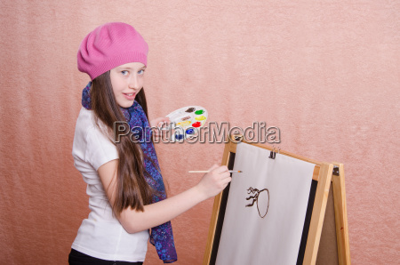 the girl begins to draw picture