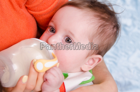 six month old baby drinking milk