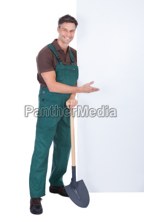 male gardener presenting blank placard