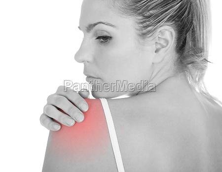 woman having shoulder pain