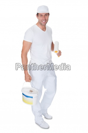 painter holding a paint roller and