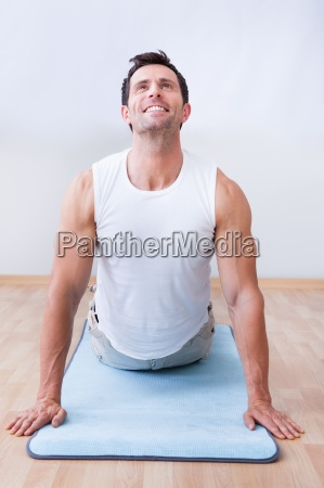 young man exercising on exercise mat