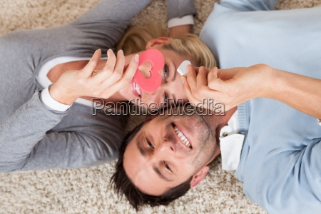 man and woman lying head to