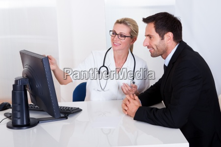 doctor explaining something to a male