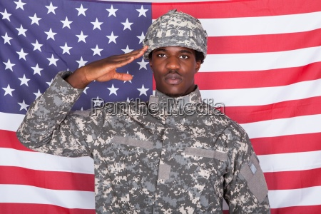 army soldier saluting in front of