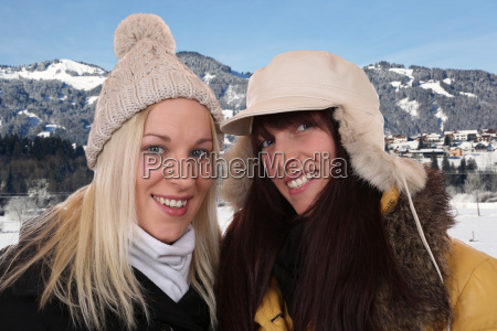 two laughing women on holiday in