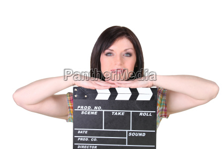 relaxed woman leaning on a cinema