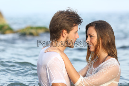 young couple in love bathing in