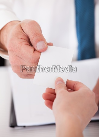 two business people exchanging card
