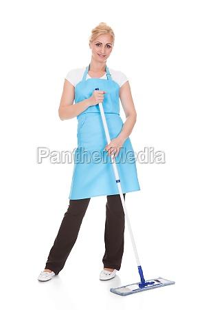 portrait of woman holding broom