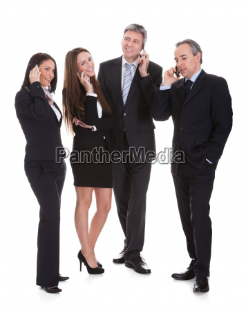 group of businesspeople gossiping