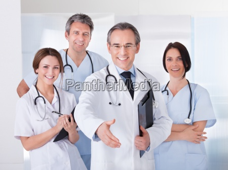 doctor extending his hand to shake