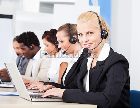 beautiful young woman talking on headset