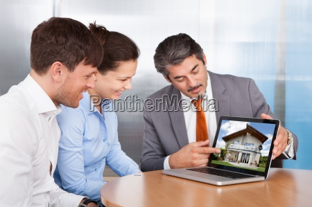 couple and consultant discussing together