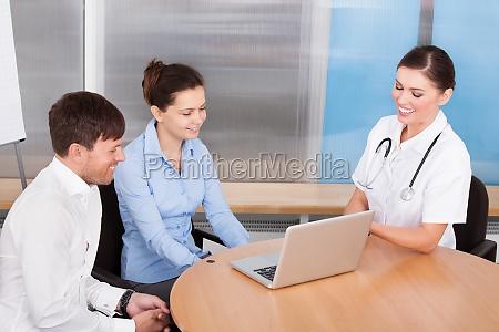 female doctor explaining to woman