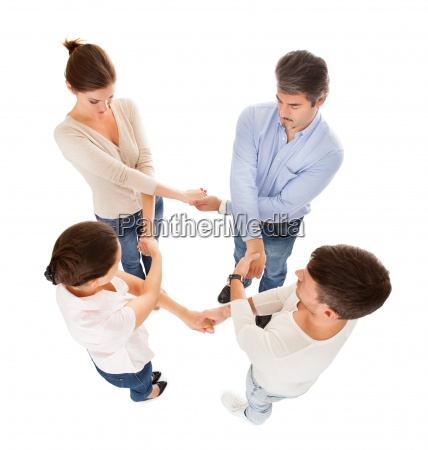 group of people holding each others