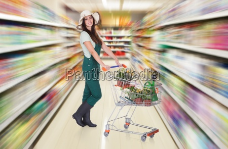 woman holding shopping cart