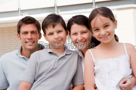 beautiful young family together outdoor