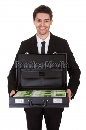 businessman with suitcase full of cash