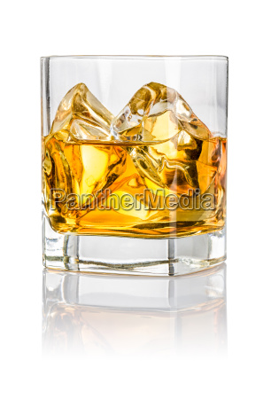 tumbler with whiskey on the rocks