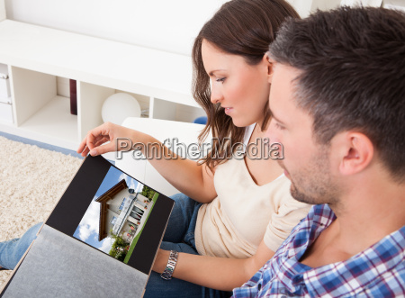 couple sitting on couch looking at