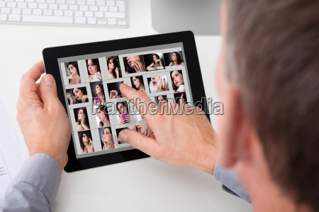 man browsing pictures of young woman