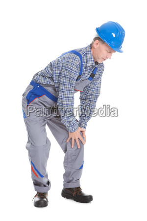 male worker suffering from knee pain