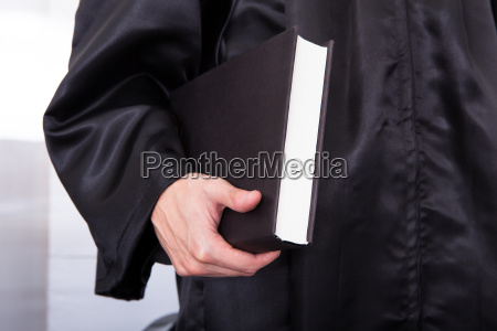 male, judge, holding, law, book - 12508998