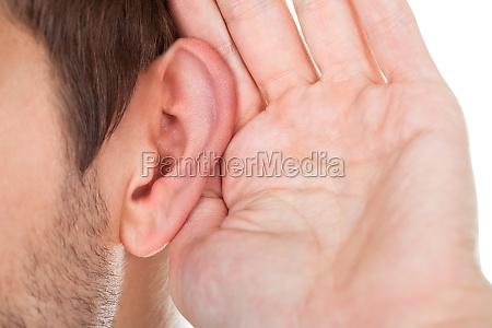 close-up, of, hand, near, ear - 12509172