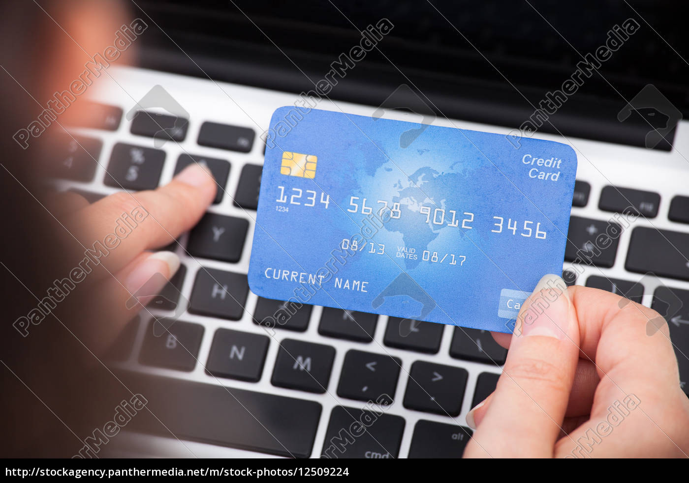 person, holding, credit, card, using, laptop - 12509224