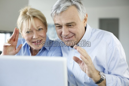 senior couple connected with family on