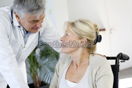 portrait of surgeon talking to patient