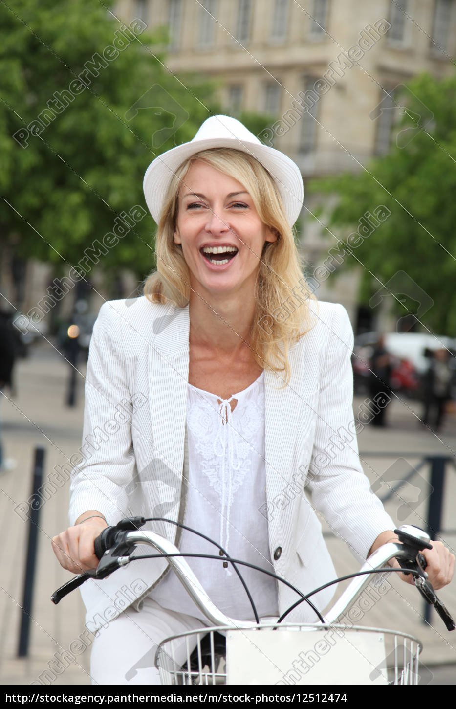 cheerful, middle, aged, woman, riding, bike - 12512474